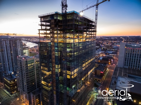 Construction site progress photo taken at twilight in downtown Nashville, TN. Image by Aerial Innovations of TN.